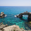 Rocky arch in the sea in Cyprus near Agia Napa - Stock Photo