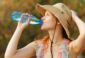 Beautiful girl drinks water — Stock Photo