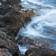 Waves crushing onto rocks — Stock Photo