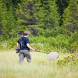 Biologist exploring a bog — Stock Photo #3653463