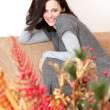 Stock Photo: Beautiful brunette relaxing on sofa