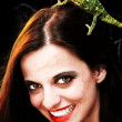 Devilish womwith chameleon — Stock Photo #3653644