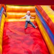 Stock Photo: Little girl enjoying slide