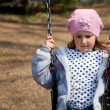 Little girl in the swing — Stock Photo