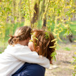 Mother hugging her daughter — Stock Photo