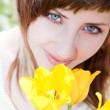 Portrait with tulips — Stock Photo