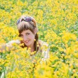 Girl in a rapeseed field — Stock Photo