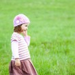Little girl having fun outdoors — Stock Photo