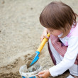 Little girl playing in the sand — Stock Photo #3654216