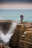 Tourist getting splashed — Stock Photo