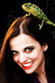 Devilish woman with chameleon — Stock Photo
