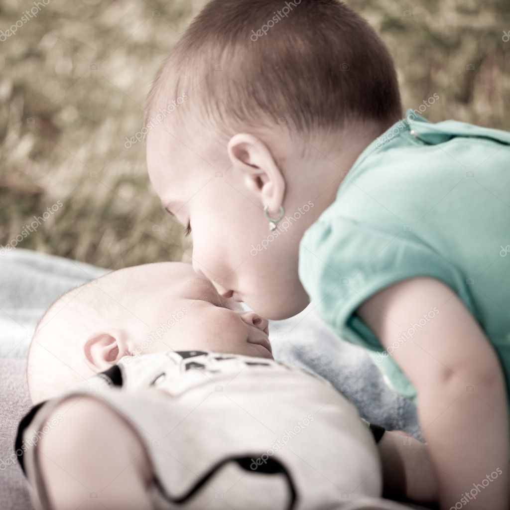 Bay girl giving a kiss to her new born baby brother — Stock Photo #3653215