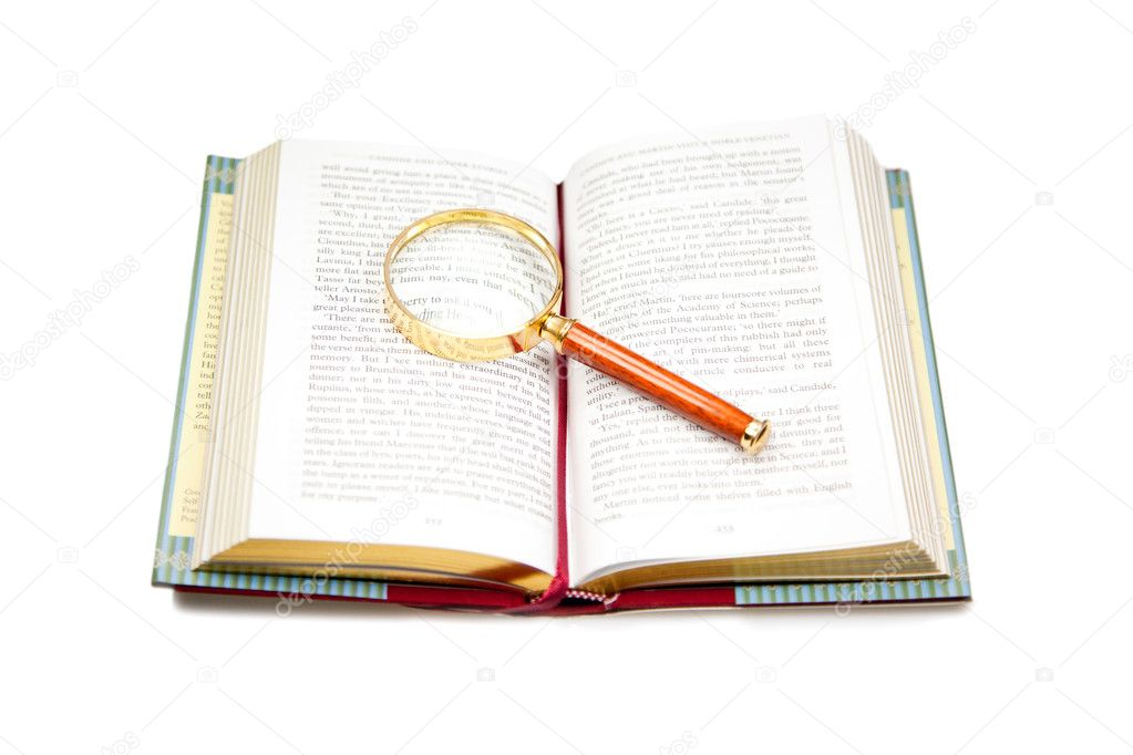 Open book with magnifying glass isolated on white.  Stock Photo #3705229