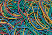 Background with a pile of colorful rubber elastics. — Stock Photo