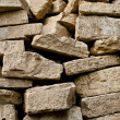 Stacked pile of construction bricks — Stock Photo