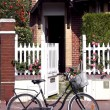 Bicycle in fron of a house - Stock Photo
