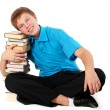 Stock Photo: Young handsome student with pile of books