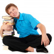 Young handsome student with pile of books — Stock Photo #3875639