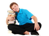 Young handsome student with pile of books — Stock Photo