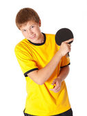 Teenage in yellow T-shirt playing ping pong — Stock Photo