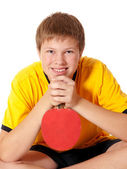 Portrait of teenage in yellow T-shirt with ping pong rocket — Stock Photo