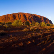 图库照片: Monolith of Uluru on rising.