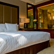 Bedroom of a elegant 5 star luxury hotel — Stock Photo #3683148