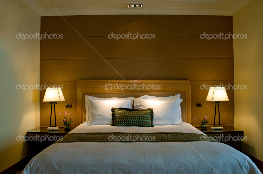 King size bed and luxury bathroom of a five star hotel suite room  — Stock Photo #3683196