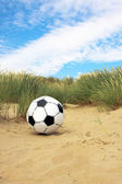 Football in the beach — Stock Photo