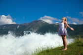 Woman near water on background of the beauty landscape — Stock Photo