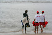 Lifeguards & surfer — Stock Photo