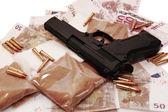Drugs vice gun and money — Stock Photo