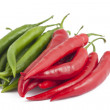 Many red and green chili peppers on white — Foto de Stock