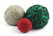Three balls of wool on white background — Photo