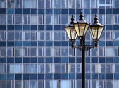 Lamp against the wall of the building — Stock Photo