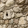 Ancient stone wall with loopholes — Stock Photo