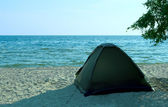 Tent on the solitude beach — Stock Photo