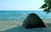 Tent on the solitude beach — Stock Photo