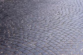 The road, covered with black stones — Stock Photo
