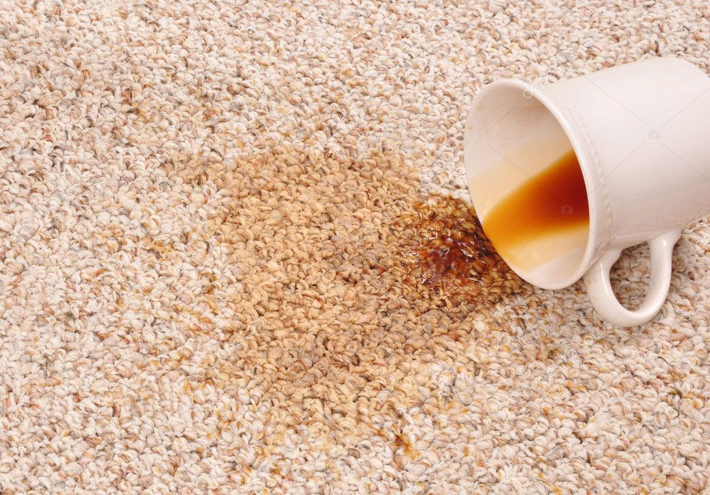 Spilled coffee on the carpet  — Stock Photo #3855908