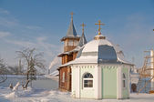 Wooden church and chapel. An orthodox female monastery — Stock Photo