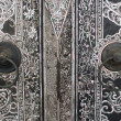 Native Thai style wood carving on door — Stock Photo #3860547