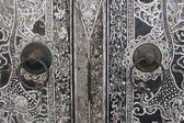 Native Thai style wood carving on door — Stock Photo