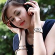 Beautiful girl listening music in the park — Stock Photo #3886633