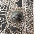 Native Thai style wood carving on door - Photo