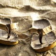 Stock Photo: Slippers on sand