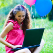 Girl with notebook and balls — Stock Photo