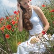 Girl in poppies — Stock Photo