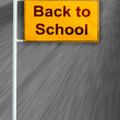 Back to school sign on moving road — Stock Photo