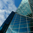 Modern office centre with sky reflection — ストック写真